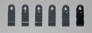 Cinco piezas grises y una pieza negra al final